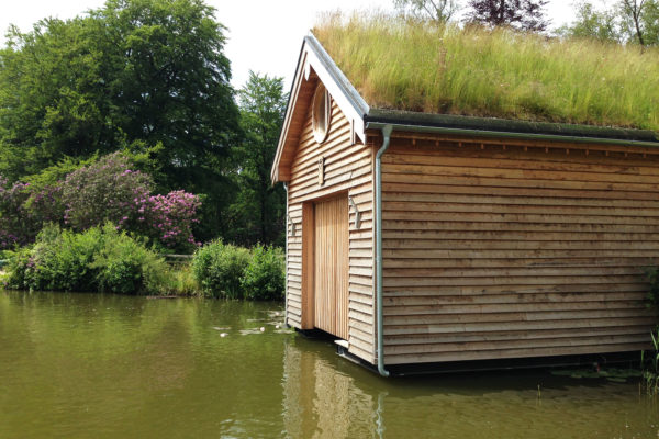 Boathouse in Avon Tyrrell with Meadow Orgnaic Roof