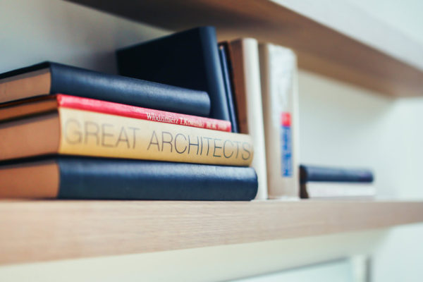 Book shelf with architecture books by Organic Roofs