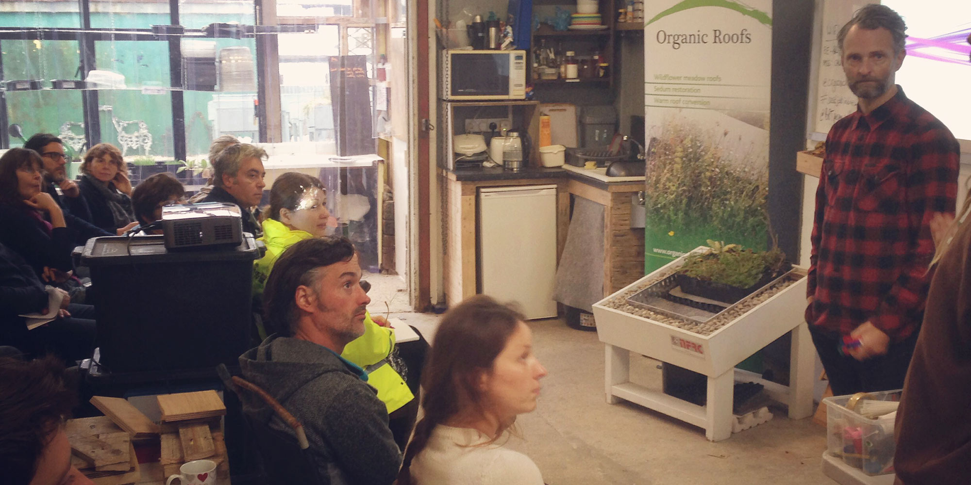 Training course with people at Organic Roofs