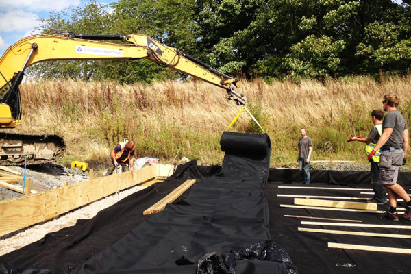 waterproofing installation for a buried helicopter hangar green roof installation