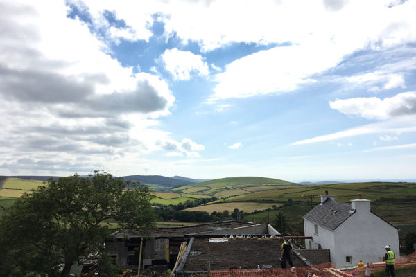 views of the hills while installing a haybase green roof in Scotland