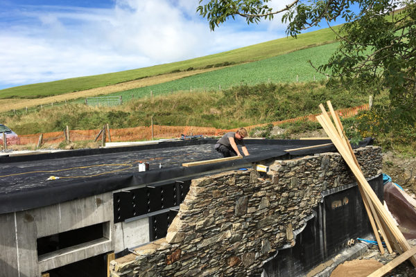 the team installing the waterproofing for green roof in Scotland