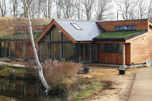 tingrith lakes during winter showing green roof design and installation
