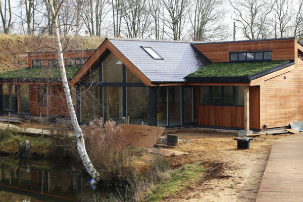 Pitched green roof in winter by Organic Roofs