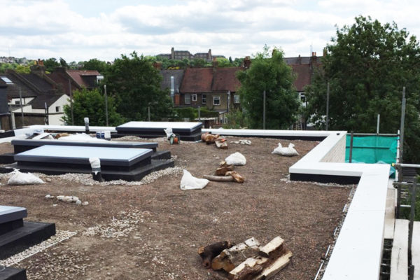 intallation of the substrate on a flat green roof with parapet capping